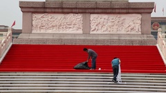 Chinese workers prepare red carpet on Tiananmen Square in Beijing, China Stock Footage