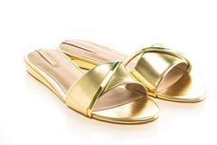 Beautiful gold sandal shoes Stock Photos