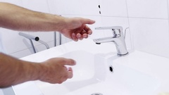 Man wash his hands with water in the bathroom, care and body hygiene Stock Footage