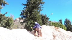 Digging in sand no snow Stock Footage