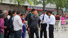 Chinese security police manages entry on Tiananmen Square in Beijing, China Stock Footage