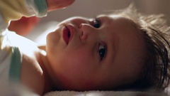 Toddler baby child looking to camera Candid take of baby laying down  Stock Footage