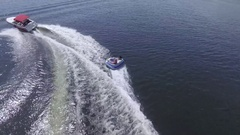 Aerial boat almost ejects tuber over wave 4k Stock Footage