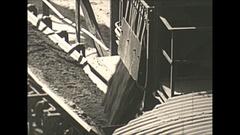 Vintage 16mm film, 1938 Coal mine surface conveyor belt, tight shot Stock Footage