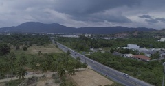 Aerial view of road and palm trees with mountains and sky backround in Kathu, Ph Stock Footage