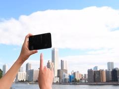 Japanese woman using smartphone downtown Tokyo, Japan Stock Footage
