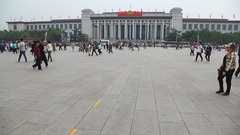 Chinese people walking on Tiananmen Square in Beijing, China Stock Footage