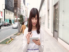 Slow motion footage of young Japanese woman with tablet in Tokyo, Japan Stock Footage
