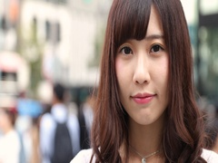 Portrait of smiling young Japanese woman in luxury area in Tokyo, Japan Stock Footage