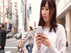 Slow motion footage of young Japanese woman with smartphone in Tokyo, Japan Stock Footage