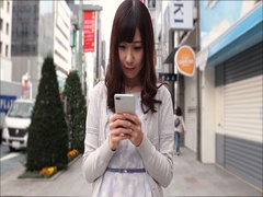 Footage of young Japanese woman walking with smartphone in luxury area in Tokyo, Stock Footage