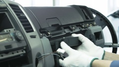 The assembling of a car dashboard on the conveyor Stock Footage