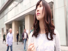 Slow motion footage of young Japanese woman taking pictures with smartphone in Stock Footage