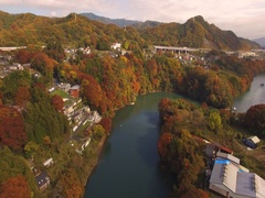 Aerial footage of Autumn colors at Sagami Lake, Kanagawa Prefecture, Japan Stock Footage