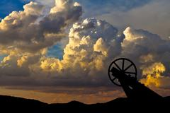 Old mining hoist with dramatic cloud background Stock Photos