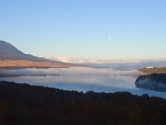Peaceful view of the fading moon over Lake Yamanaka in the morning, Yamanashi Stock Footage