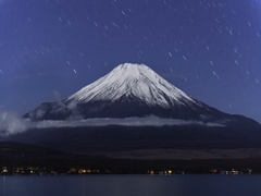 Star trail footage of the starry sky over Mount Fuji from Lake Yamanaka, Stock Footage