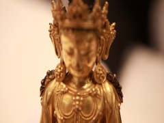 A gilt bronze figure of amitayus Stock Footage