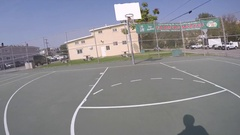 POV of a young man shooting hoops and playing street basketball. Stock Footage