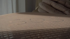 SOS written on dusty table Stock Footage