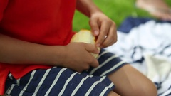 Removing the skin of an orange  Child peeling an orange with his hands Stock Footage