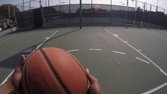 POV of a young man shooting free throws while playing street basketball. Stock Footage