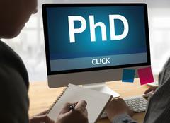 PhD Doctor of Philosophy Degree Education Graduation ,  Knowledge , Success.. Stock Photos