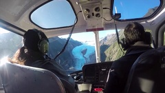 Flying a helicopter to the Franz Josef Glacier in New Zealand Stock Footage