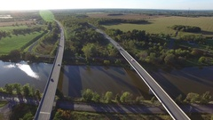 Aerial busy highway bridges over river from high above 4k Stock Footage