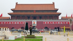 Chinese officer and portrait of Mao Zedong on Tiananmen Square in Beijing, China Stock Footage