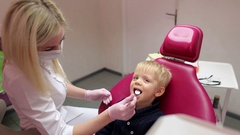Dentist examines teeth of a small boy. Stock Footage