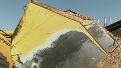 Crane shot of a loader removing sawdust Stock Footage