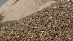 Pile of wood chips to storage for export Stock Footage
