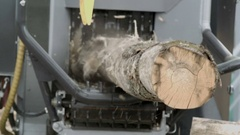 Tree trunk getting into bandsaw making sawdust Stock Footage