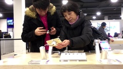 People playing iphone at Best Buy store with 4k resolution Stock Footage