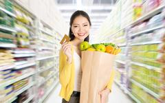 Buying groceries in marketplace Stock Photos