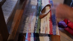 Detail of an old loom a woman who works and make a door mat of rags Stock Footage