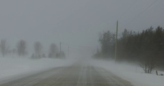 POV dashcam winter driving on snow covered roads in Ontario Canada Stock Footage