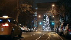 Washington Square Park Christmas tree under arch taxi cab driving at night NYC Stock Footage
