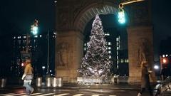 People walking late at night on Washington Square Park North crosswalk NYC Stock Footage