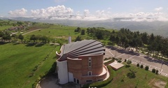 Aerial 4k drone shot above italian Church flying at a landscape around Church Stock Footage
