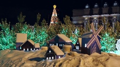 Decorated christmas trees and miniature houses Stock Footage