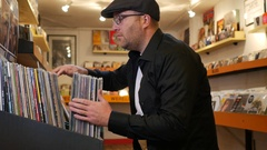 Man browsing records in the vinyl record store Stock Footage