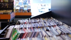 Closeup of browsing records in the vinyl record store Stock Footage