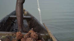 Detail of a fishing net pulled out by African fisherman Stock Footage