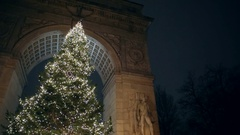 Christmas tree lights night under Washington Square Park arch New York City NYC Stock Footage