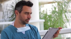 Young medical crew man with tablet Stock Footage