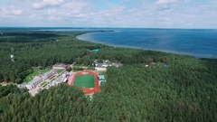 Summer children's camp on the shore of the lake, with a bird's-eye view. Stock Footage