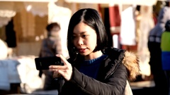 Young pretty asian woman recording video Stock Footage