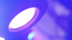 Reflector with colored light that moves over a metal scaffolding in du Stock Footage
